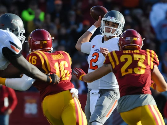 Oklahoma State Cowboys quarterback Mason Rudolph (2) passes against the Iowa State Cyclones at Jack Trice Stadium.