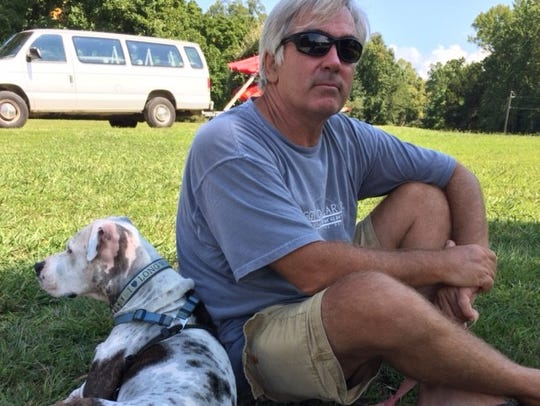 Steve McKibben with his dog Patches after Irma struck