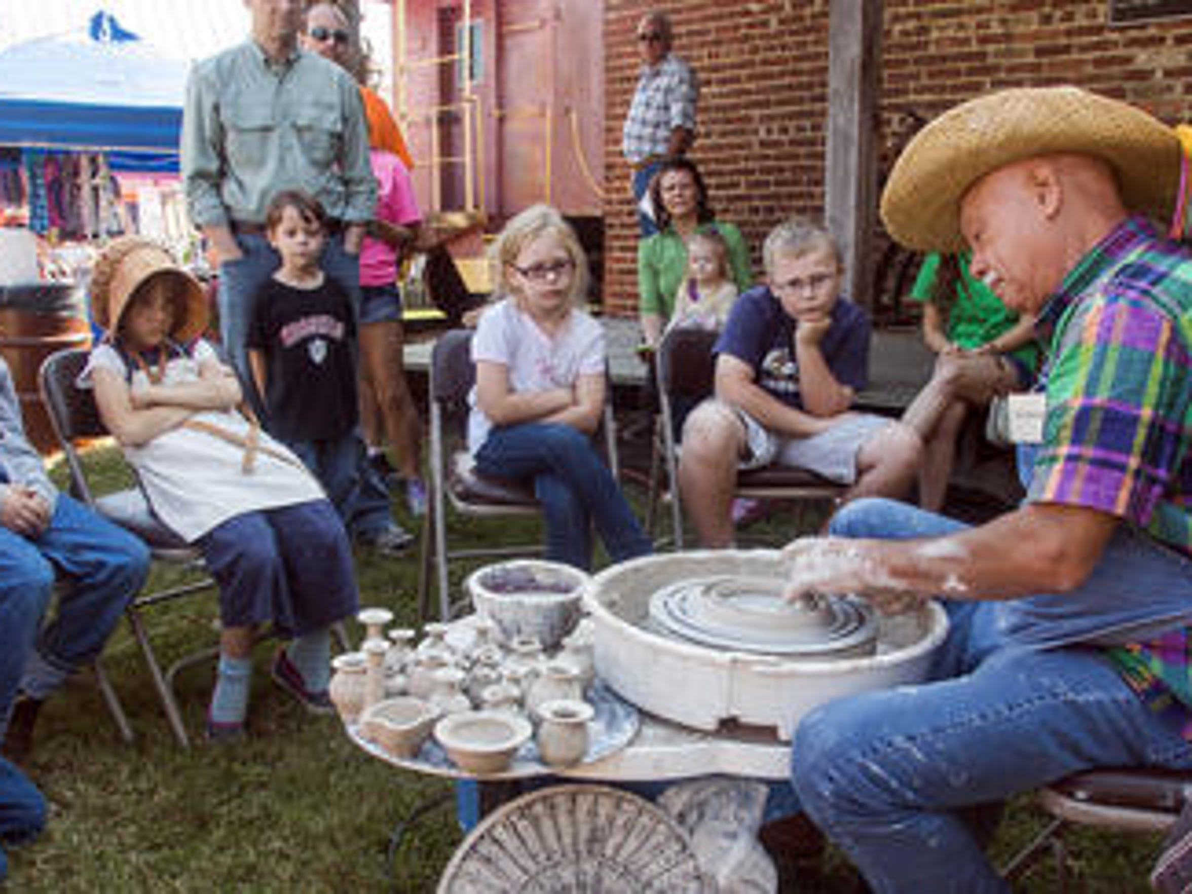 SATURDAY -- Roy Overcast demonstrates the art of pottery as a crowd watches at Harvest Days Saturday at Cannonsburgh Pioneer Village in Murfreesboro in 2014.