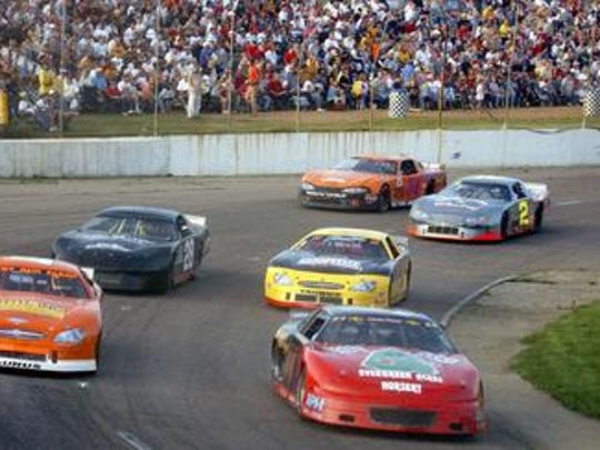 Racers compete in the Cenex Mini Stock heat during the Larry Detjens Memorial Race at State Park Speedway