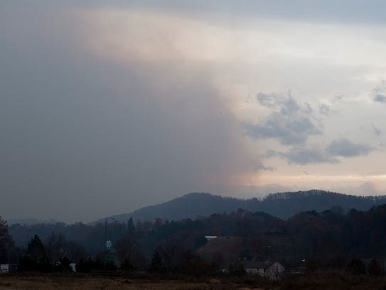 Smoke rises from the Great Smoky Mountains as seen