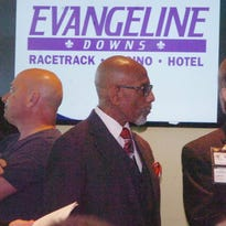 Sen. Elbert Guillory, center, talks with Evangeline Downs Racetrack and Casino vice president and general manager Bret Cox during a press conference Wednesday to announce the start of the thoroughbred horse racing season.