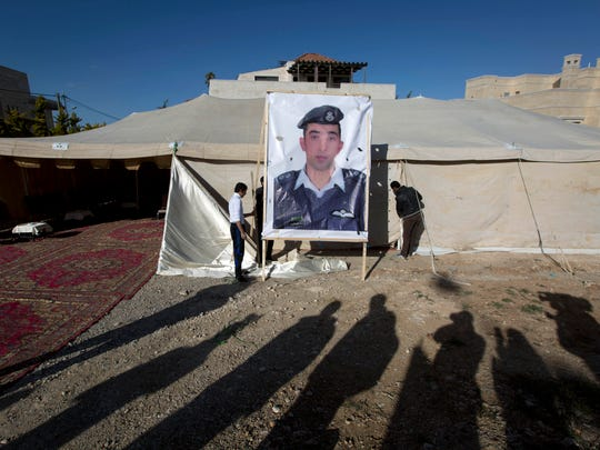 A banner with a picture of Jordanian pilot Lt. Muath
