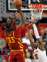 Iowa State's Solomon Young (33) shoots over Texas Tech's Norense Odiase (32) during the first half of an NCAA college basketball game Wednesday, Feb. 7, 2018, in Lubbock, Texas. (AP Photo/Brad Tollefson)