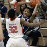 Loyola's Dominique Kennedy looks to pass the ball during a game against Woodlawn. Kennedy will continue his basketball career at Centenary College.