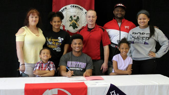 SJCC senior Chris Morrisette continues his football career at Bluffton University. He's joined at his announcement by mother, Kim Sorg, sister Briana Morrisette, SJCC coach Brian Spicer, father, Kenny Morrisette and sister, McKayla Morrisette (back row, left to right). Brother, Brayden, and sister, Kapri are in the front row.