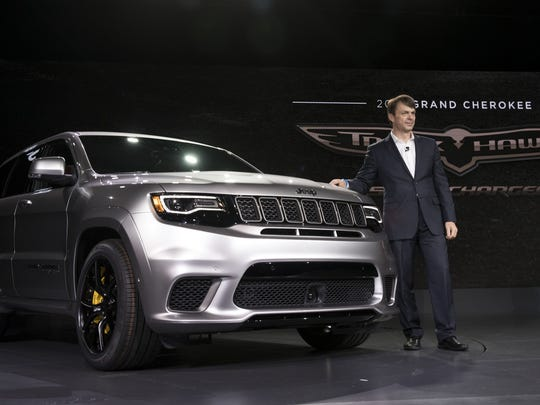Mike Manley, President and CEO of Jeep, stands next to the 2018 Jeep Cherokee Trackhawk at the New York International Auto Show in April 2017 in New York City.