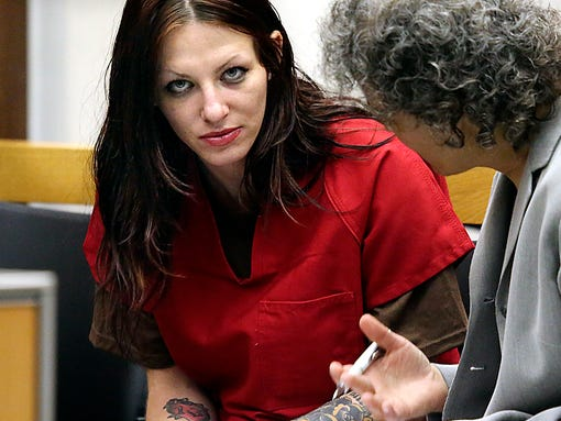 Alix Tichelman, left, 26, of Folsom, Calif., confers with public defender Diane August, right, during her arraignment in Santa Cruz Superior Court Wednesday, July 9, 2014, in Santa Cruz, Calif. Tichelman is facing manslaughter charges for the November 2013 death of Forrest Hayes, a Google executive. A Silicon Valley success story turned sordid this week with the arrest of an upscale prostitute who allegedly left Hayes dying on his yacht after shooting him up with a deadly hit of heroin. Hayes, 51, was found dead by the captain of his 50-foot yacht Escape. (AP Photo/Santa Cruz Sentinel, Shmuel Thaler)