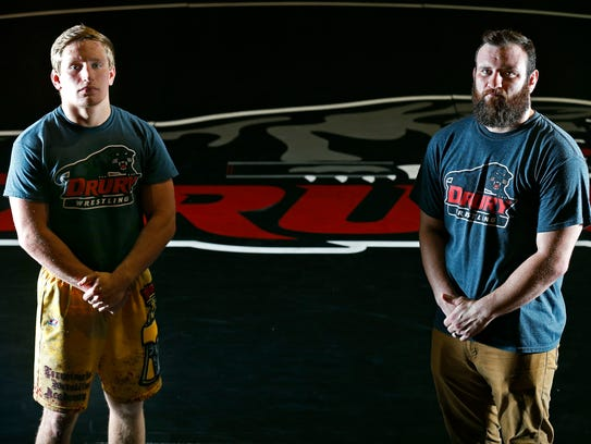 Wrestler Kyle Caldwell and head wrestling coach James