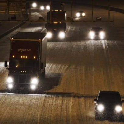 I-65 in Clarksville, Ind., covered with snow on Thursday,