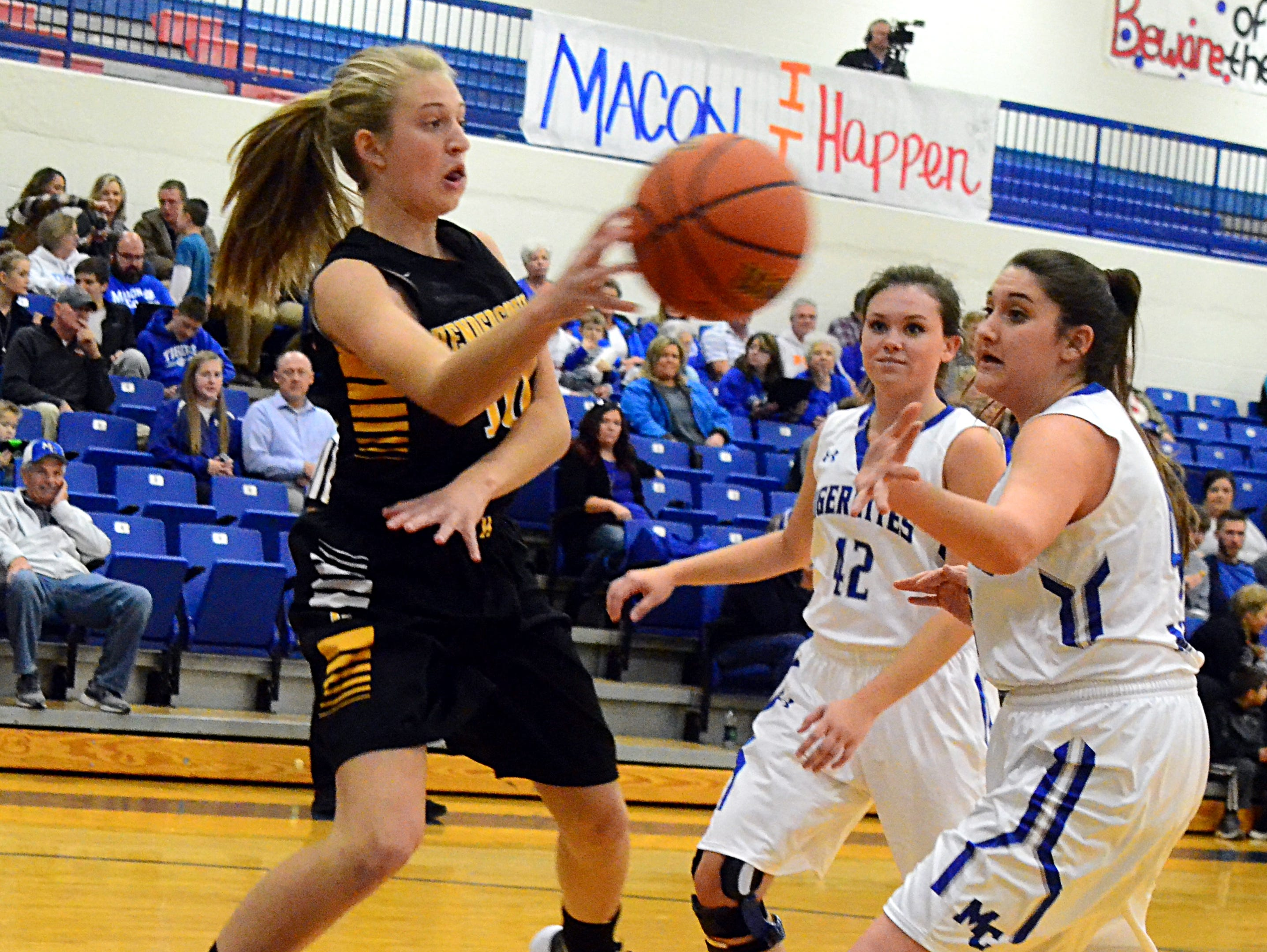 Hendersonville High sophomore Brooke Long saves a ball inbounds during first-quarter action. Long scored 10 points in the Lady Commandos' 48-42 victory at Macon County on Monday evening.