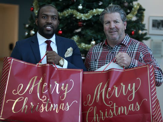 Orrin White (left) with the United Way of Delaware and Tom Donovan, Northeast Regional President with Gannett East Group, wish Delaware a Merry Christmas in this 2017 file photo.
