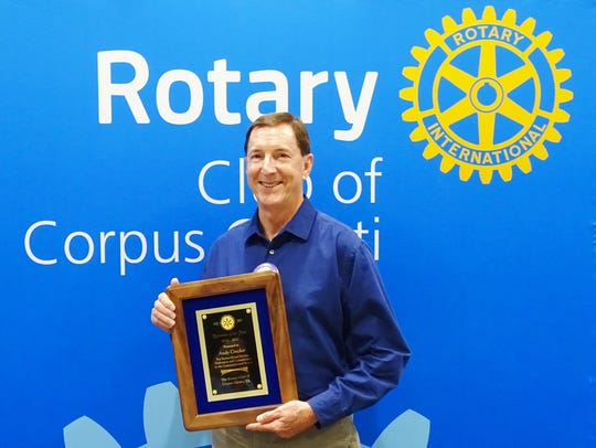 """Andy Crocker receives the """"2016-2017 Rotarian of the"""