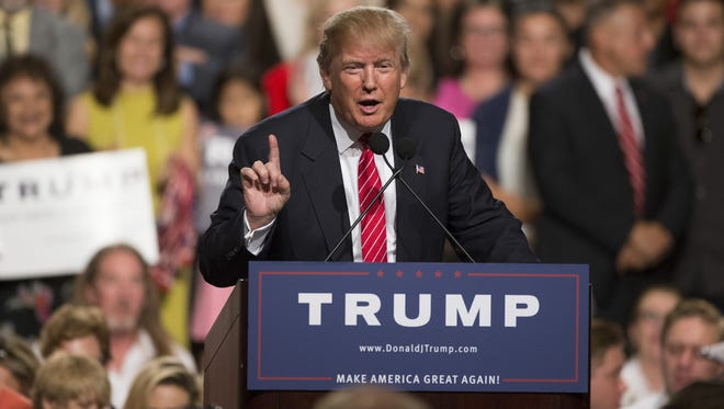Republican presidential candidate Donald Trump speaks during a rally at Phoenix Convention Center on July 11, 2015.