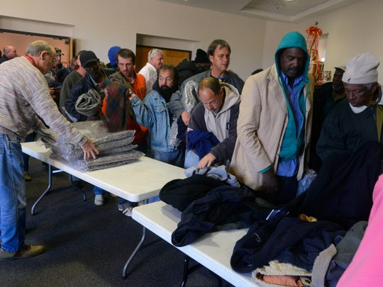 The less fortunate get free blankets and coats Saturday during the Christmas Dinner for the Homeless at First Baptist Church. Free haircuts, a dinner, toys for children and blankets and coats were all included.