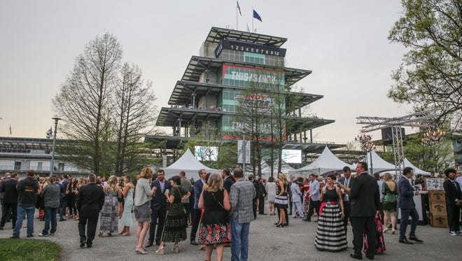 IndyCar fans mix and mingle at the annual Rev Indy fundraiser held at the Indianapolis Motor Speedway on Saturday, May 5, 2018. Proceeds from the event support the Indiana Health trauma and critical care programs, which provides care for fans and drivers at the IU Health Emergency Medical Center at IMS.