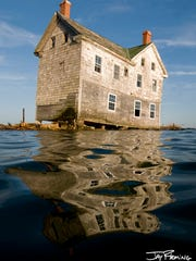 The last house on Holland Island is shown six months