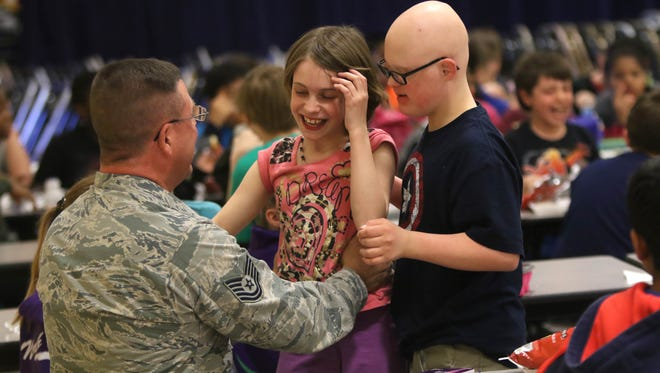 Full of happiness, 11-year-old Jessica Grieten reacts to the appearance of her father, Tech Sgt. John Grieten, after he stopped by during her lunch time to surprise her with his return from deployment with the Delaware Air National Guard. Grieten has been gone since Oct. 3 serving in Southwest Asia.