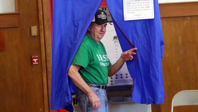 Tom Hazzard leaves a voting booth after casting his vote in the 2016 Presidential primary election at Highland Elementary School on Tuesday afternoon.