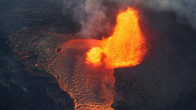 Kilauea's lower east rift zone eruption continues, as fissure 8 continues to effuse lava at a high rate, feeding a massive river that flows toward the coast in Pahoa, Hawaii on May 31, 2018.