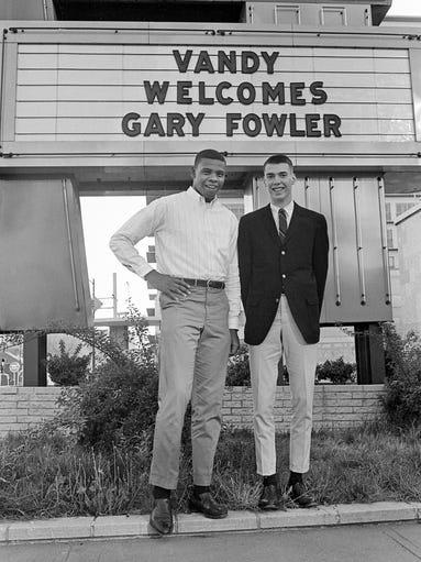 Basketball recruit Gary Fowler, right, gets an official