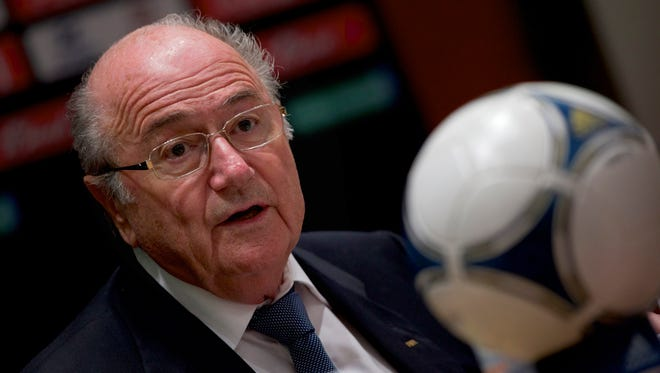 This is a Sept. 30, 2012 file photo of FIFA President Sepp Blatter speaking during a news conference in Moscow.