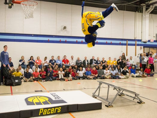 Pacers mascot Boomer does a quick dunk show during
