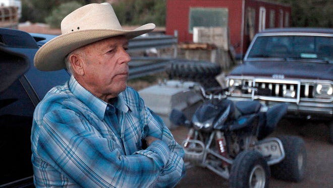 In this Saturday, April 5, 2014, file photo, Cliven Bundy, stands at the Bundy ranch near Bunkerville, Nev.