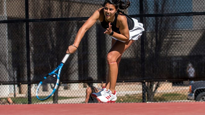 In this undated photo provided by Southern Utah Athletics, Ghita Nassik hits the ball during tennis practice at Southern Utah University in Cedar City, Utah. Southern Utah announced June 23, 2020, it was eliminating its men's and women's tennis programs effective immediately due to budget cuts brought on by the coronavirus pandemic.