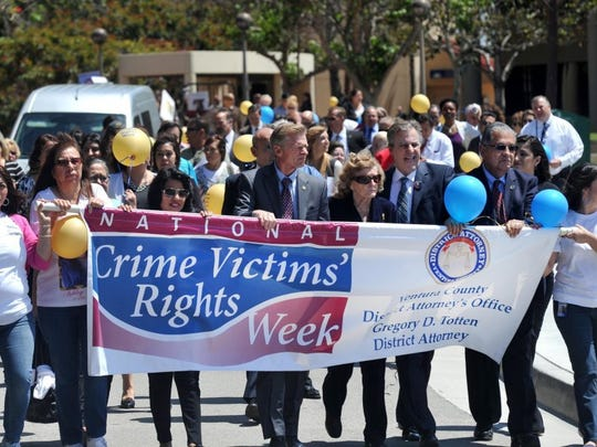 Ventura County District Attorney Greg Totten and others participates in a march during a past National Crime Victims' Rights Week ceremony at the Ventura County Government Center.