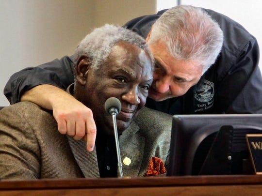 Shelby County Commissioner Terry Roland (right) huddles with Commissioner Walter Bailey in a 2015 commission meeting. Roland says he didn't realize a resolution Monday, sponsored by Bailey, made previously ineligible two-term commissioners like himself eligible for life and health benefits.