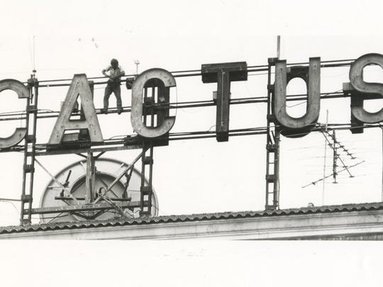 Standard-Times file A worker atop the Hotel Cactus works to anchor and wire in a new antenna in 1985. The building was constructed in 1928, one of the early hotels in the Hilton chain.