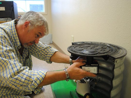 In this TRN file photo, Jim Monkres, Wichita Falls Utilities supervisor I, Water Distribution, assembles a cutout display of the new automated water meter. The 34,000 water meters the city bought to replace its old water meter system are expected to be fully installed by the summer.