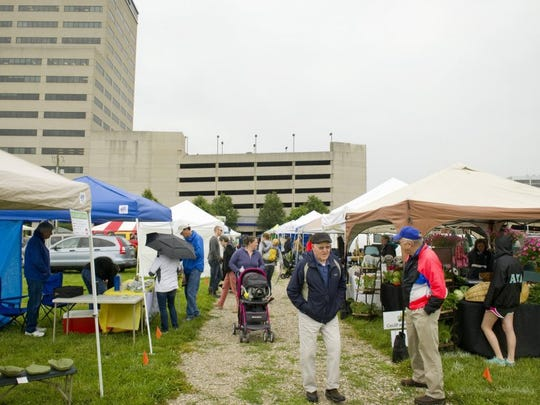 DENNY SIMMONS / COURIER & PRESS Gray skies didn't dissuade too many visitors from attending the first Downtown Evansville Farmers' Market of 2016 Friday morning.