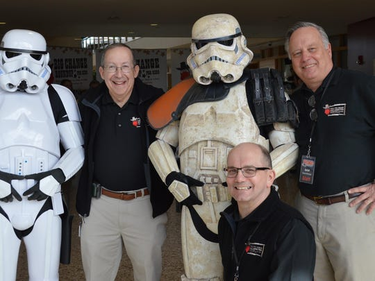 Dr. Lewis First, chief of pediatrics at the UVM Children's Hospital with C.K. Coin and Dan Dubonnet from WOKO-FM pose with some Storm Troopers that made a guest appearance for the Big Change Roundup.