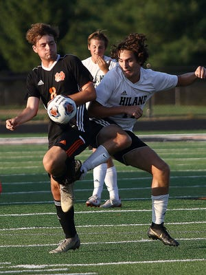 Marlington's Macagey Laure, left, and Hiland's Caleb Beachy go for the ball during their game at Marlington Stadium on Saturday, August 22, 2020.