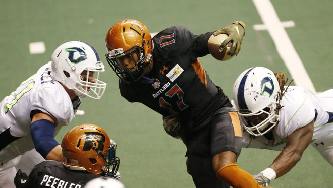 Arizona Rattlers' Dezmon Epps (17) escapes a tackle by Nebraska Danger's Myke Tavarres (44) before scoring during IFL action at Talking Stick Resort Arena in Phoenix May 27, 2018.