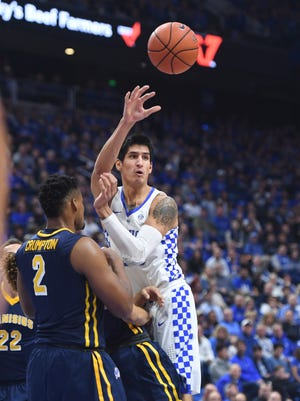 UK's Derek Willis passes the ball during the University of Kentucky basketball game against Canisius at Rupp Arena in Lexington, Ky. on Sunday, November 13, 2016.