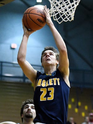 Haslett's Sam Laczynski scores during the second quarter on Wednesday, March 7, 2018, at the Don Johnson Field House in Lansing.
