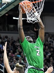 Novi's Traveon Maddox Jr. dunks the ball and is fouled during the fourth quarter on Friday, March 23, 2018, at the Breslin Center in East Lansing.