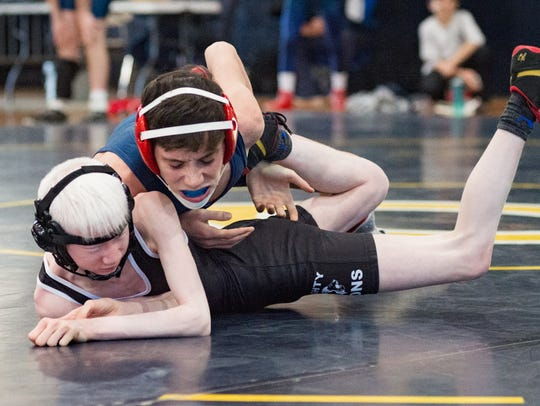 Teurlings Catholic's Coen Begnaud collects a win at the Greg Lavergne Duals Championship Tournament on Saturday at Carencro.
