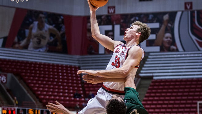 Ball State's Ryan Weber fights for a shot past Chicago State's defense during their game at Worthen Arena Thursday, Dec. 31, 2015.