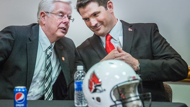 Replacement Ball State football coach Mike Neu chats with president Paul Ferguson during a press conference for Neu at Worthen Arena Friday afternoon.