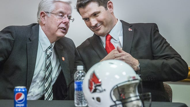 Ball State President Paul Ferguson resigned two weeks after this press conference to announce new football coach Mike Neu.