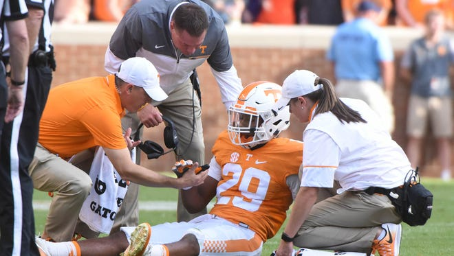 Tennessee defensive back Evan Berry  is checked out by staff during the first half at Neyland Stadium on Nov. 5, 2016 against Tennessee Tech.