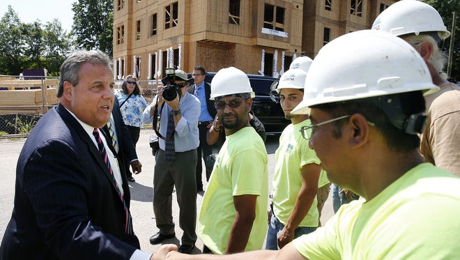 Gov. Chris Christie shakes hands with workers after making a Department of Community Affairs Affordable Housing Announcement at the Woodbridge Affordable Housing Construction Site on Bunns Lane Friday, Aug. 25, 2017.