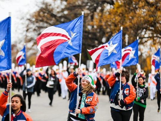 The San Angelo Central High band marches in a parade Thursday honoring wounded warriors who are participating in the Lone Star Warriors Outdoors deer hunt this weekend near San Angelo.