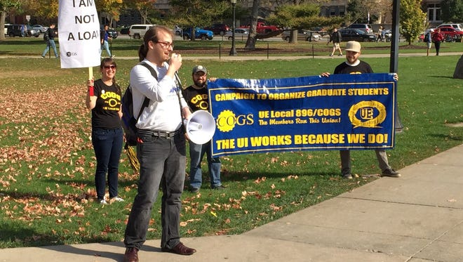 Landon Elkind, president of COGS UE Local 896, speaks out Nov. 1 before a bargaining session with officials from the University of Iowa and the Iowa Board of Regents.