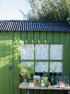 Brighten your backyard shed with weather-resistant paint in one of nature's shades.