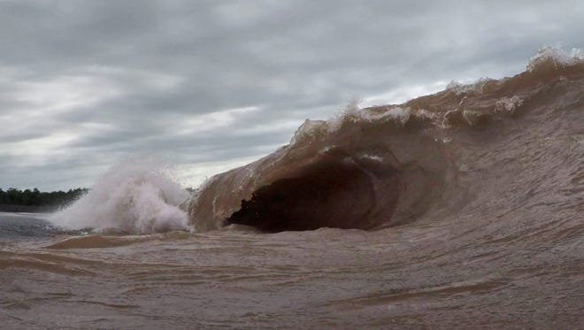 A barreling wave crashes onto the beach at North Canal Township Park in Michigan's Keweenaw Peninsula on July 29, 2015. A gale over Lake Superior created the high surf, unusual during summer, but common during autumn.